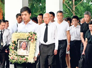 Death of matriarch lifts veil on Singapores first family