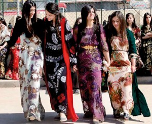 Iraqi students wearing traditional Kurdish clothing celebrate International Women's Day in Arbil, the capital of Kurdistan.