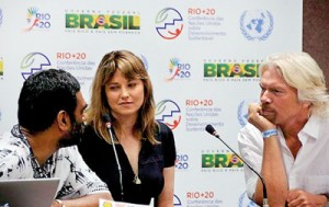 "Executive Director of Greenpeace International Kumi Naidoo (L) actress Lucy Lawless (C) and entrepreneur Richard Branson take part in a Greenpeace press conference at the Rio+20 UN conference on sustainable development in Rio de Janeiro, Brazil on June 21. Greenpeace announced several celebrities had joined a campaign for a ""global sanctuary"" around the North Pole (AFP)"