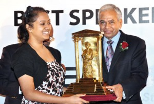 � Proud moment:  Receiving the winner's trophy from Bartleets' Chairman Eraj Wijesinghe. Pic by Indika Handuwala�