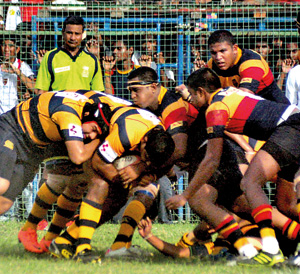 Irshad Cader officiating the first leg of the Royal-Trinity rugby game at the Royal Complex last Saturday which Trinity won 34-11.
