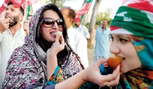 Supporters of Pakistani cricketer turned politician Imran Khan of Pakistan Tehreek-i-Insaaf (PTI - Movement for Justice) eat sweets while they celebrate following the verdict against Pakistani Prime Minister Yousuf Raza Gilani in Islamabad on June 19. AFP