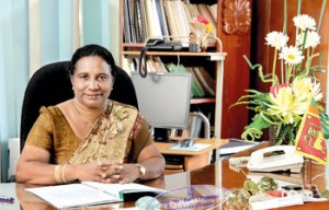 Badra Kamaladasa at her office after assuming duties at a simple ceremony. Pic by M.A. Pushpa Kumara