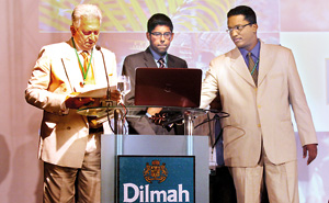 Merril J Fernando and his two sons - Malik (centre) and Dilhan at a Dilmah Distributors Conference a few years ago.