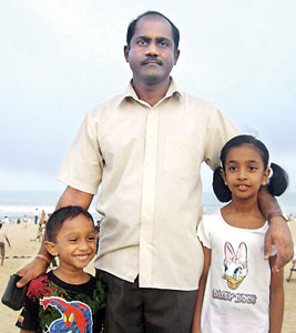 Glad they were spared: Dr.  Aathavan with his children