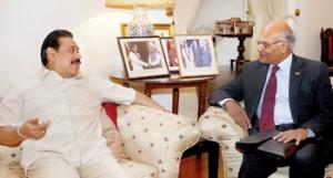President Mahinda Rajapaksa in conversation with India's National Security Advisor Shiv Shankar Menon