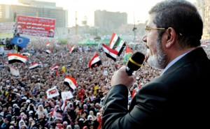 Egypt's Islamist President-elect Mohamed Mursi delivers a speech in Cairo's Tahrir Square (REUTERS)