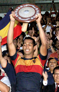 Kaneel Seneviratne, the Trinity skipper raises the Bradby Shield.