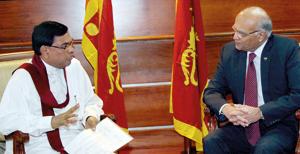 Economic Development Minister Basil Rajapaksa  in conversation with  India's National Security Advisor Shiv Shankar Menon