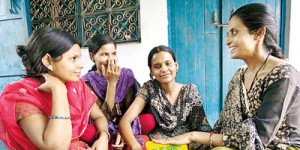 Rama Devi shows women in Dungra Jogi the tampons