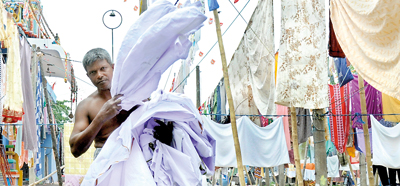 Generations-old laundry workers may be  squeezed dry by  modernisation