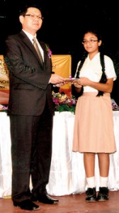 Muqaddasa Wahid, a Grade 7  student of Buddhist Ladies College launched a book titled  'Role Model Series' recently.  She presented her book to the chief guest, Tan Lee Lung, Deputy High Commissioner of Malaysia.