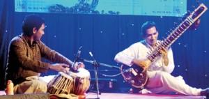 Peshala Manoj on tabla, Pradeep Ratnayake on sitar, and Abaji on an assortment of exotic stringed instruments.Photos: Mangala Weerasekera