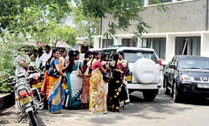 People waiting outside the Secretariat in Ampara for job interviews