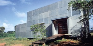A winner: A cube-shaped structure stands between water and the rugged terrain