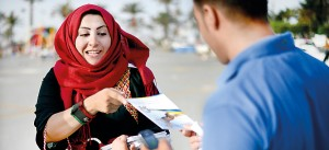 Libyan Justice and Construction supporters distribute and explain party leaflets during a Libyan National Assembly Campaign rally at Martyrs Square. AFP
