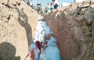 Upsetting: This image released by the Syrian opposition's Shaam News Network shows the mass burial of people allegedly killed by Syrian government forces in Douma