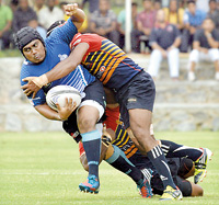 A Navy player is tackled by an Up Country Lions player. - - Pic by Amila Gamage