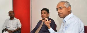 From left : K. Romeshun, Prof Sirimal Abeyratne and Eran Wickramaratne.  Pic by Amila Gamage