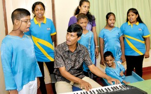 Music therapy: Nadun Hettiarachchi with his students.Pic by Susantha Liyanawatte