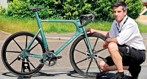 Project manager Simon Roberts poses with the new Aston Martin super cycle, which comes with a �25,000 price tag. Dubbed the 'world's most technologically advanced' bike, the elegant One-77 was based on the firm's �1 million namesake supercar and was launched earlier this month