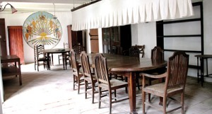 The dining room as it was in years gone by: The dining table with the pankha and the mural on the far wall. Pix by Indika Handuwala