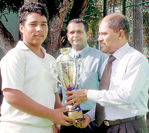 Rahil Atheeq captain of Lyceum International Wattala receiving the R.I.T. Alles Challenge Trophy from the Director of Gateway College Dr. Harsha Alles. Also in the picture is Sajith Liyanage, chief organizer of the tournament.