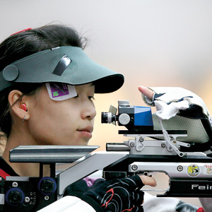 China's Yi Siling competes during the 10m Air Rifle Women qualification at the London 2012 Olympic Games at the Royal Artillery Barracks in London, July 28, 2012. AFP