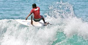 Asanka braving the waters at Arugam Bay