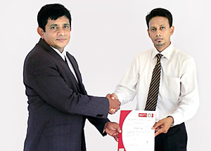 Picture shows Managing Director of Lanka Minerals & Chemicals M. U. Bopitiya (left) receiving the ISO certificate from Wasantha Gunarathne, Manager Country Business Development of Bureau Veritas Lanka (Pvt) Ltd.