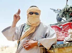 An Islamist rebel of Ansar Dine gestures near rebel-held Timbuktu in northern Mali. AFP