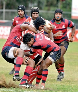 A CH player is brought down by the Red Shirts. - Pic by Ranjith Perera