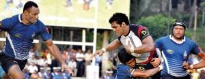 Kandy flyhalf Fazil Marija is well tackled by Navy fullback Reeza Mubarak. - Pic by Amila Gamage