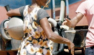 A woman pays for her pot of water