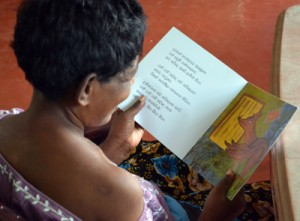 A resident engrossed in the beautiful world of a picture story book. Pix by Hasitha Kulasekera