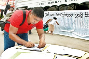 Collecting signatures outside the Colombo Fort Railway Station.