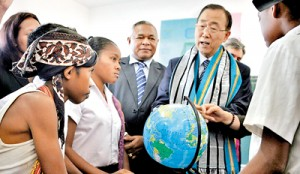 United Nations Secretary General Ban Ki-moon holds a globe as he speaks to East Timorese school children during a visit in Likisa on August 16. AFP