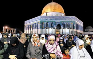 Palestinian women pray in front of the Dome of the Rock, on the compound known to Muslims as al-Haram al-Sharif (Noble Sanctuary) and to Jews as Temple Mount, during Laylat ul-Qadr in Jerusalem's Old City. AFP