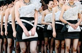 Chinese firefighters teach hostess girls in mini-skirts and stilettos