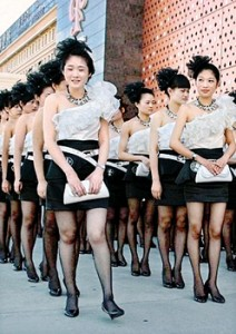 Dressing up: The waitresses arrived at the fire station in Wenling, Zhejiang province, wearing stiletto heels and full make-up