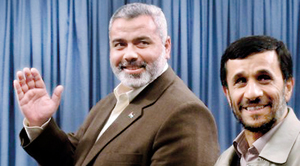 Iranian President Mahmoud Ahmadinejad (right) invited Palestine Prime Minister Ismail Haniyeh (left) to NAM conference (Reuters)