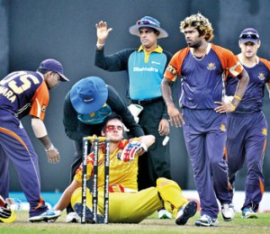 South Africa batsman Rilee Rossouw who turns out for the Basnahira Cricket Dundee is hit on the face by Lankan speedster Lasith Malinga. The sequence of pictures taken by our staff cameraman Amila Gamage shows how the incident took place at the R. Premadasa Cricket Stadium,  yesterday.