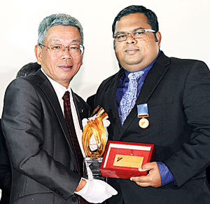 Picture shows Ravindra Soysa, Founder and Chairman of Civimech Group receiving the award.