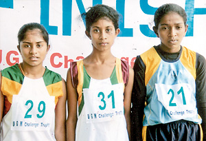Winners of the Girls race:  Winner Dulanjali Amarasooriya of Sri Rahula College  Katugastota is flanked by Lasanthika Dilrukshi of Doragala MV Kotmale right and H.M.V. Seneviratne of Sri Rahula  College Katugastota (left).