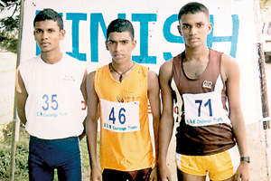 The winner Saman Pushpakumara (Pushpadana MV  Ambatenne Kandy) flanked by M.I.M. Tilakasiri (Mahinda Rajapaksa Navodaya MV Kureewela Matale) right and A.P. Murapalawatte of St. Sylvester's College Kandy (left).