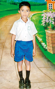 Against all odds:  Kavindu, the elder boy  is now studying   in Grade 2
