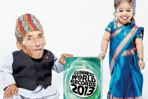 Standing tall: The world's smallest man, 72-year-old Chandra Dangi from Nepal meets Jyoti Amge, aged 18 from India, who is the shortest woman in the world as they launch the new edition of Guinness Book of Records