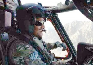 A smiling Suresh piloting a similar Black Hawk helicopter, in an undated photo, over the Kandahar mountains in Afghanistan
