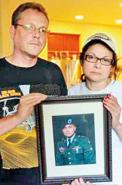 Suresh's grief-stricken parents, Suzie and Brian show a photo of their beloved son