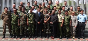 CICRA Director/CEO Boshan Dayaratne and Master Trainer Krishnan Rajagopal with a group of top military officers representing member nations of the Multinational Communications Interoperability Programme)) at the Cyber Endeavor Programme on August 16 at Changi Control and Command Centre of the Singapore Naval Base.